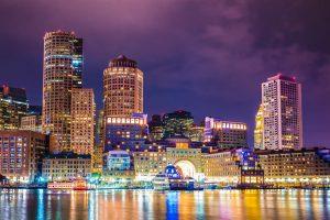 Beautiful night view of Boston Massachusetts skyline and Boston Harbor