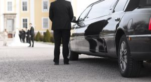 Black wedding limo with chauffeur waiting in Massachusetts